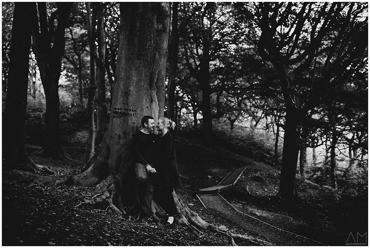 black and white of couple in woods