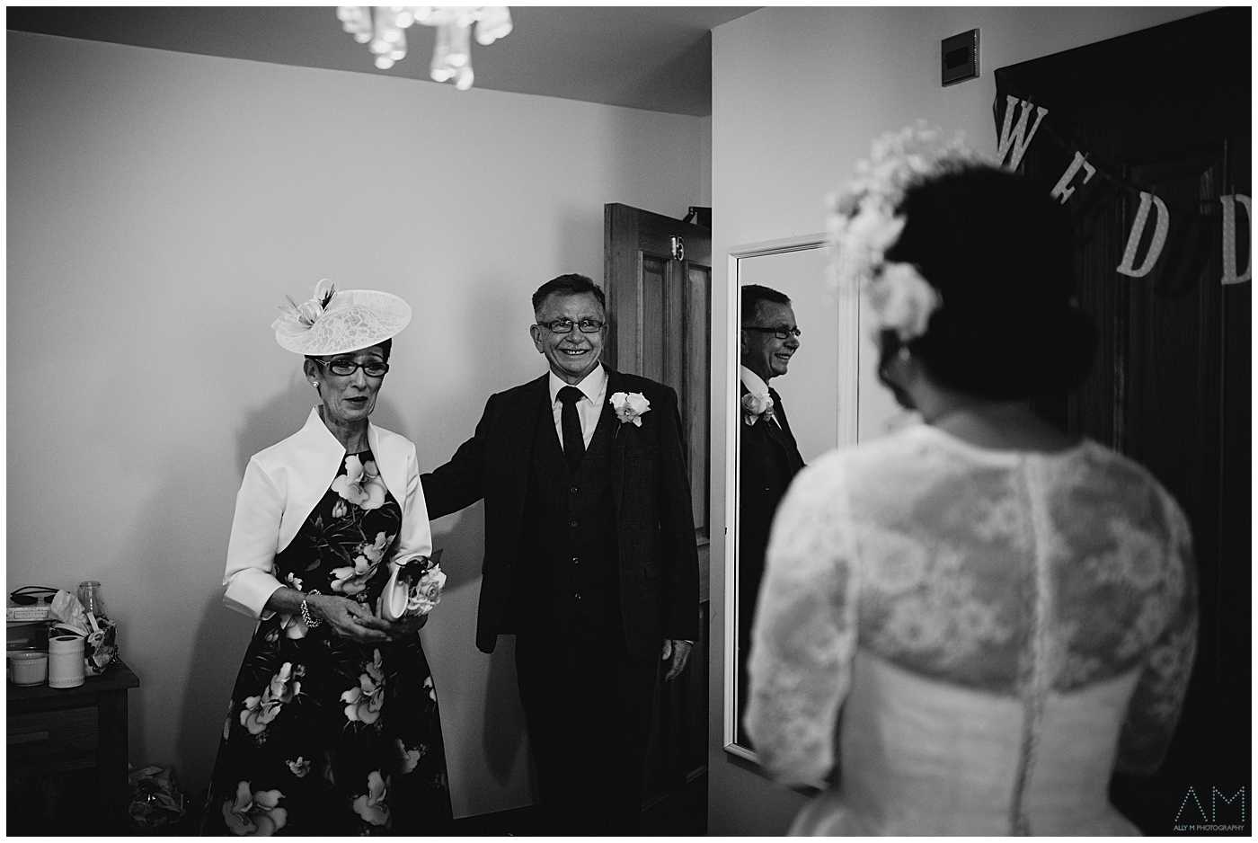 Mother and Father of the bride see her for first time in dress