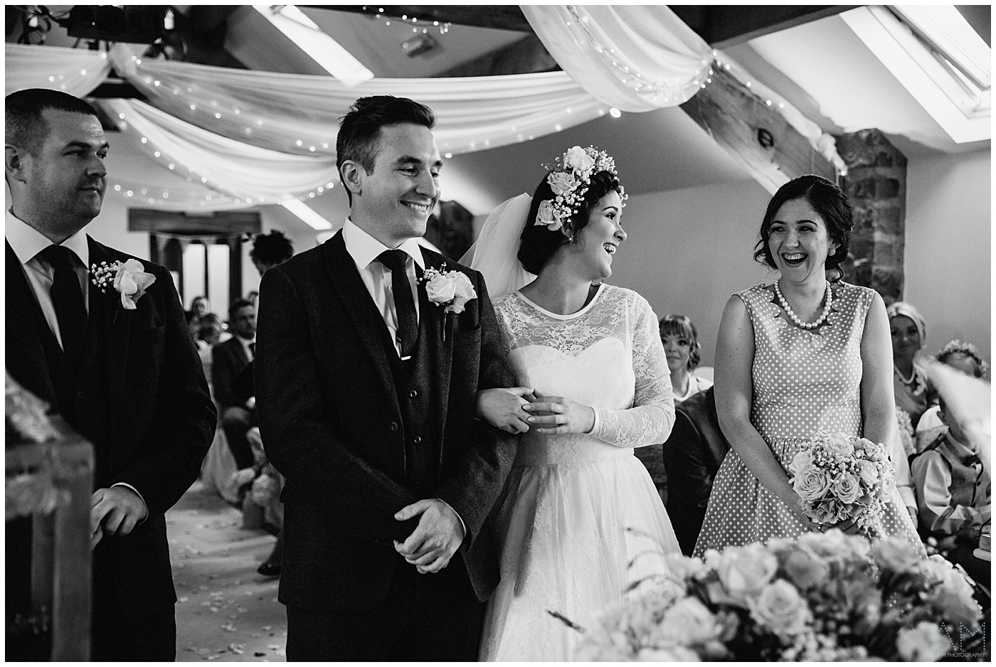 bride sharing a smile with her sister