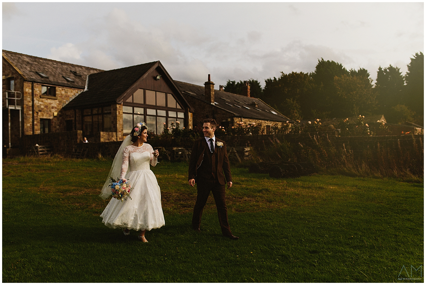 bride and groom walking together at beeston manor