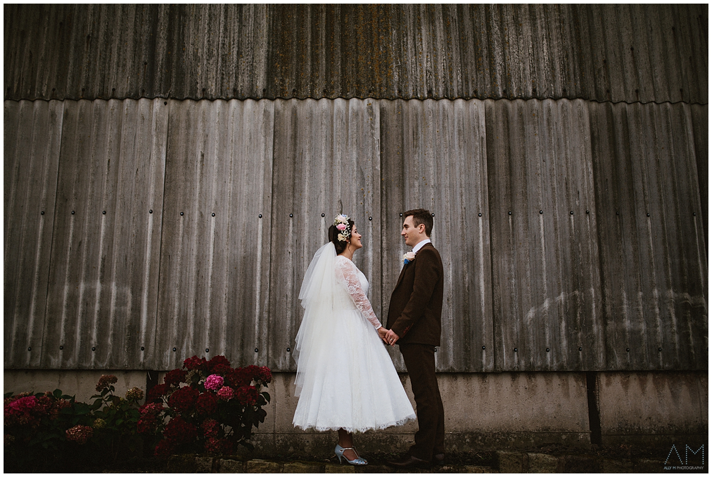 bride and groom standing on the wall