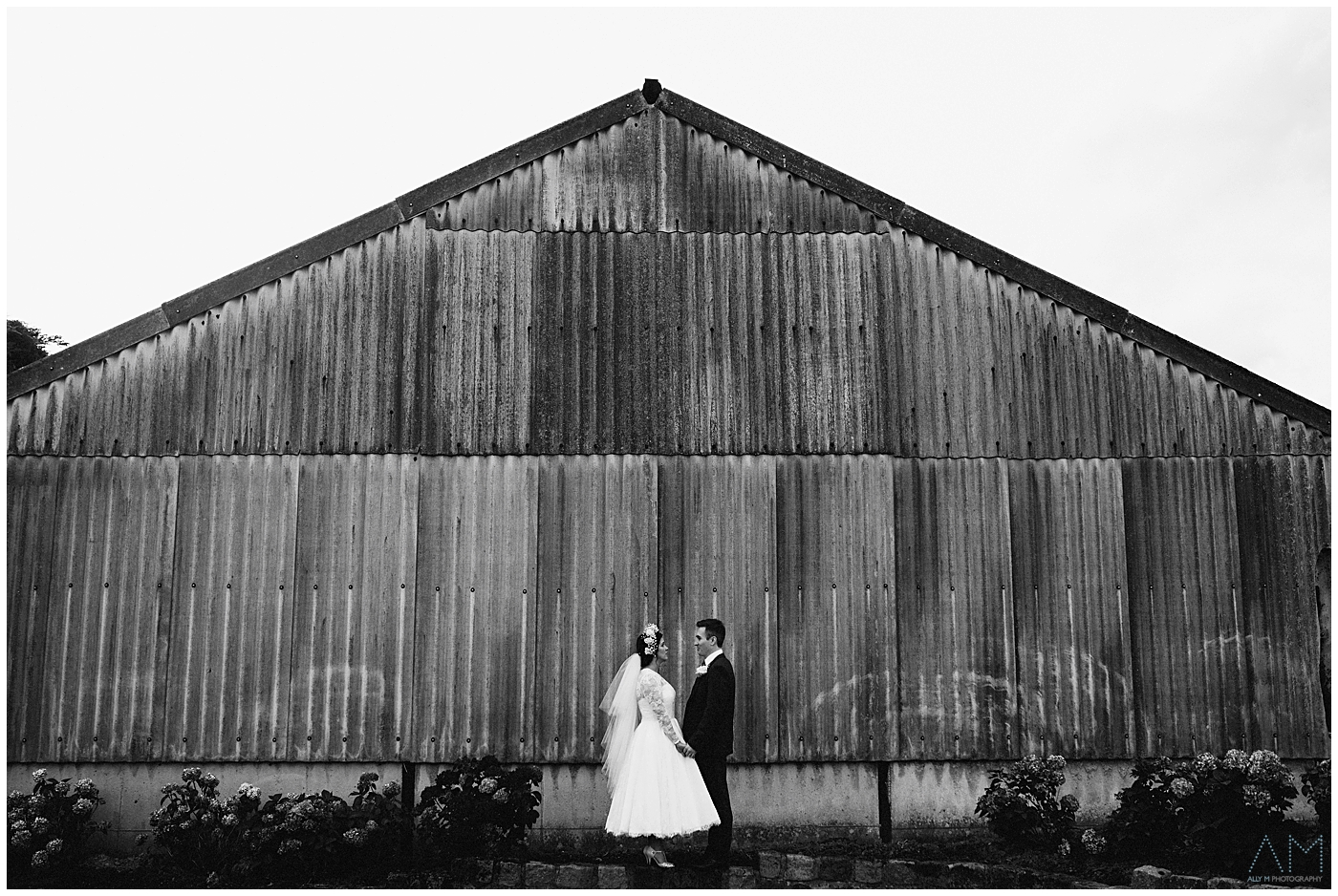 black and white photo of bride and groom at Beeston Manor