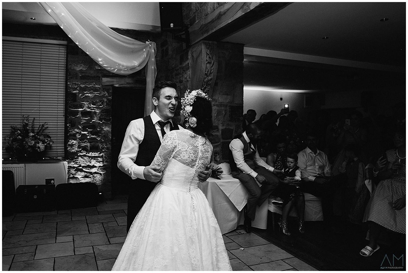 groom loving the first dance