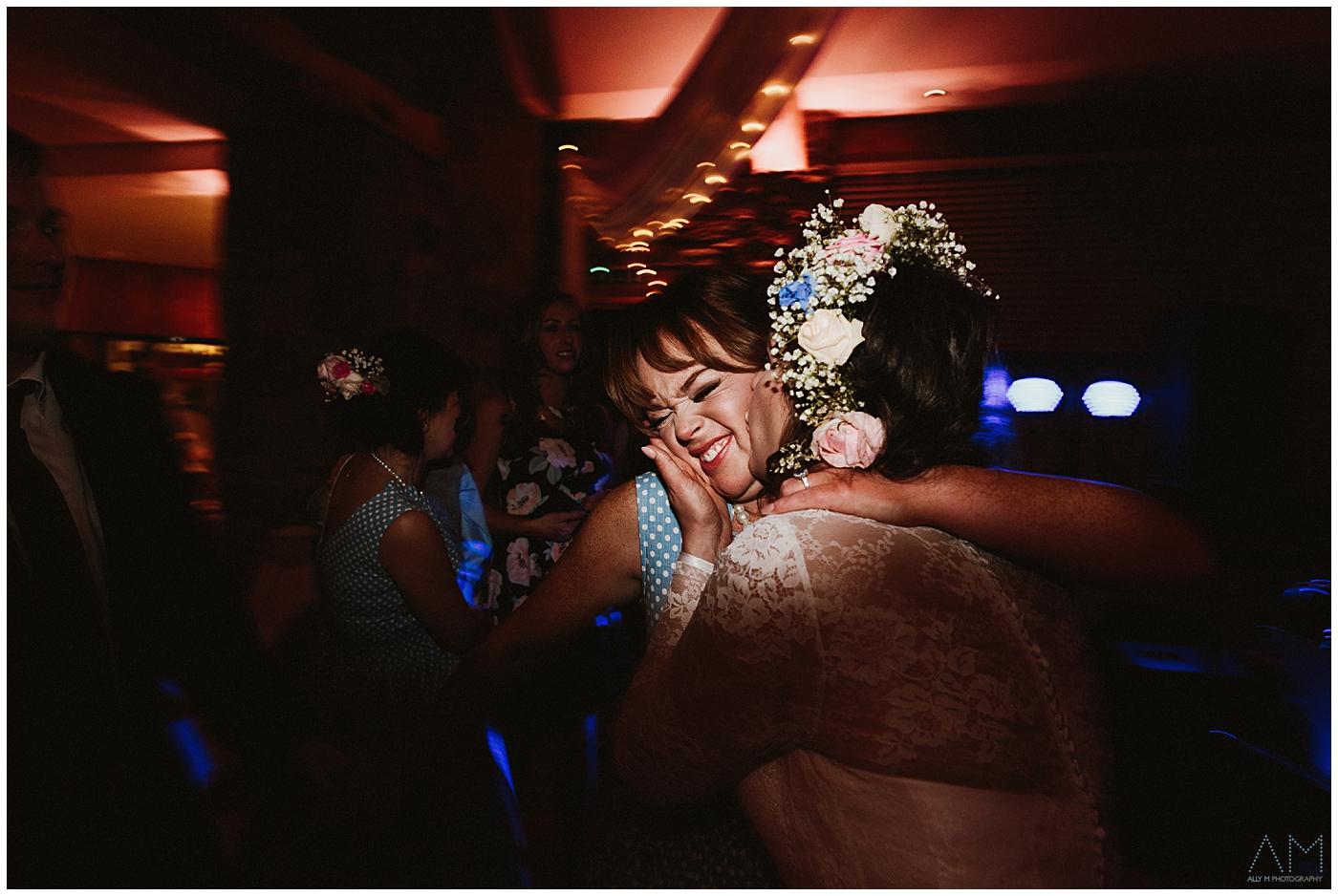 bride kissing her bridesmaid