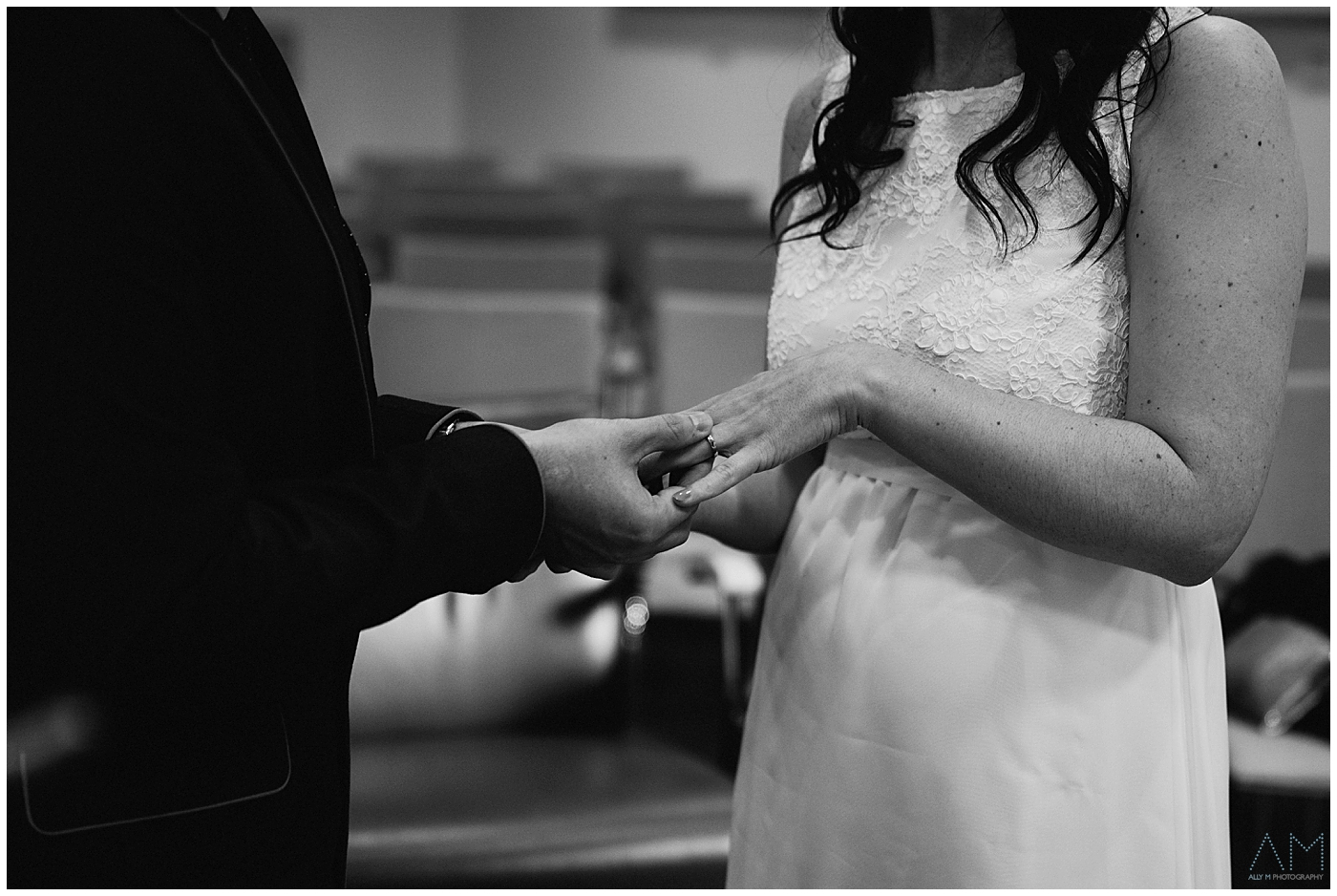 placing the wedding ring on the brides finger