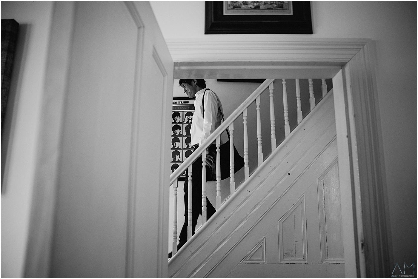 groom walking down stairs