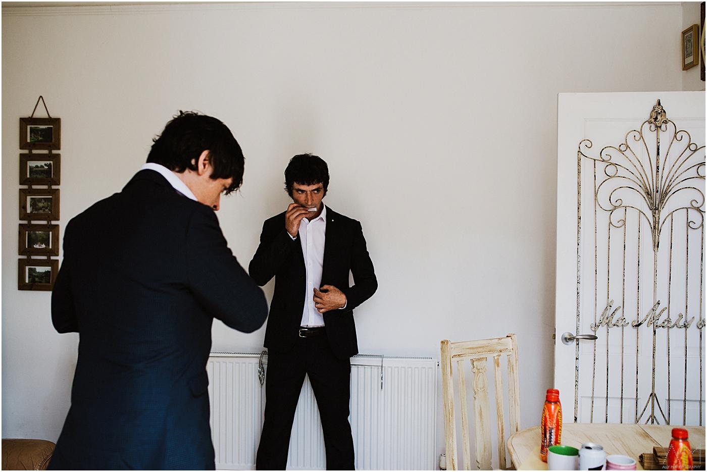 groom and best man smoking