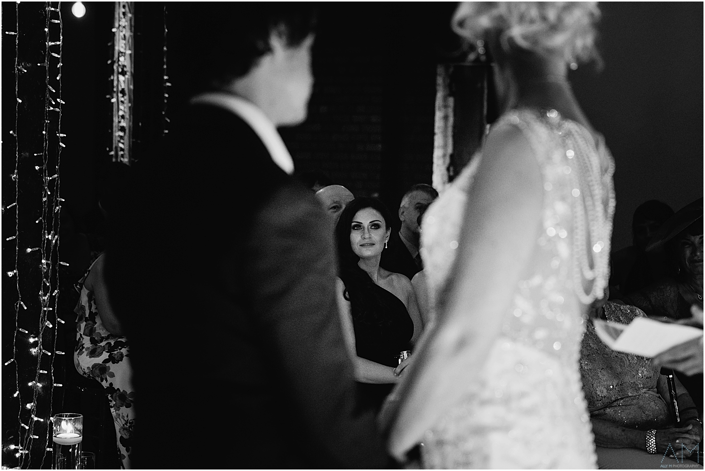 Bridesmaid looking on