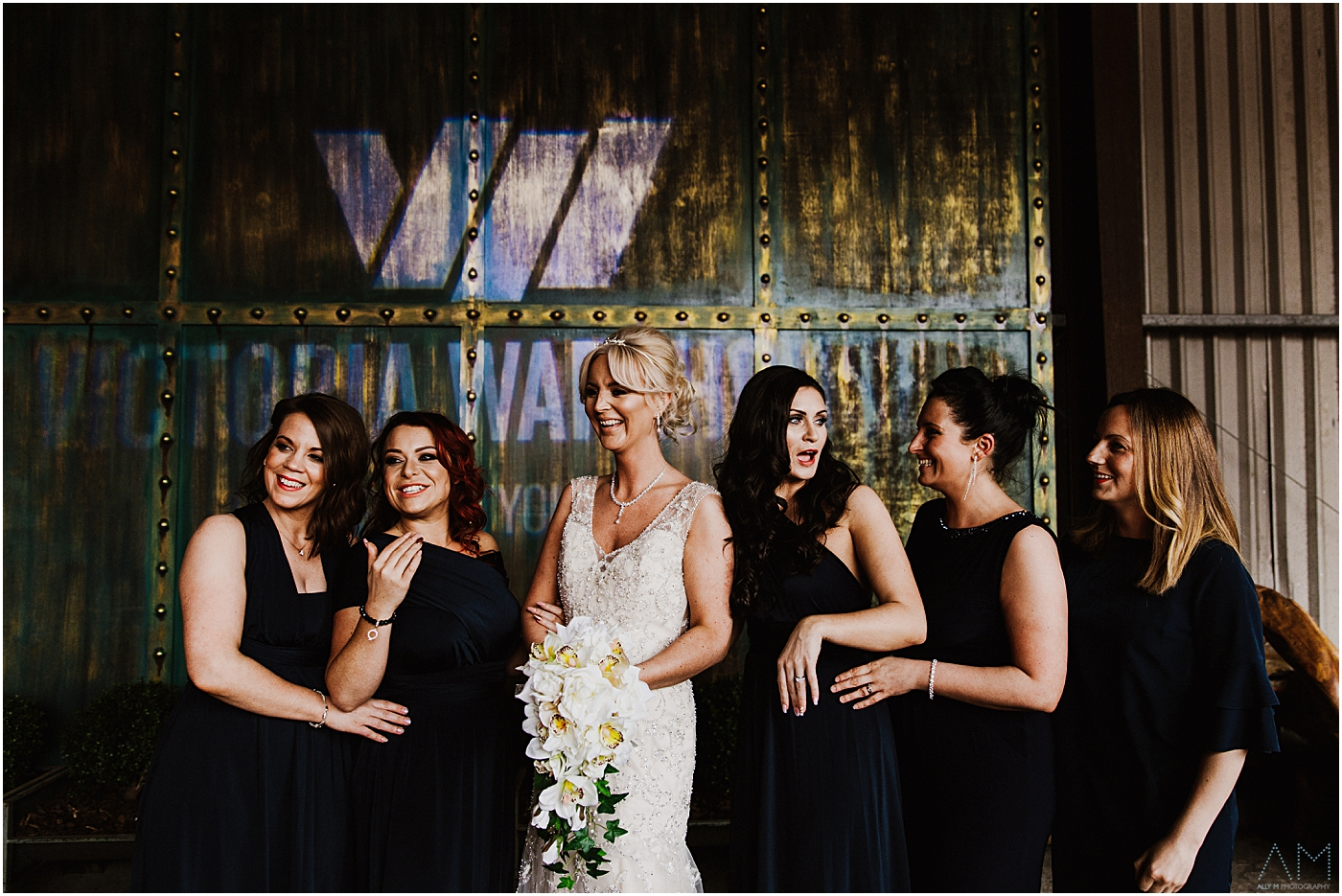 bride with her bridesmaids at Victoria warehouse