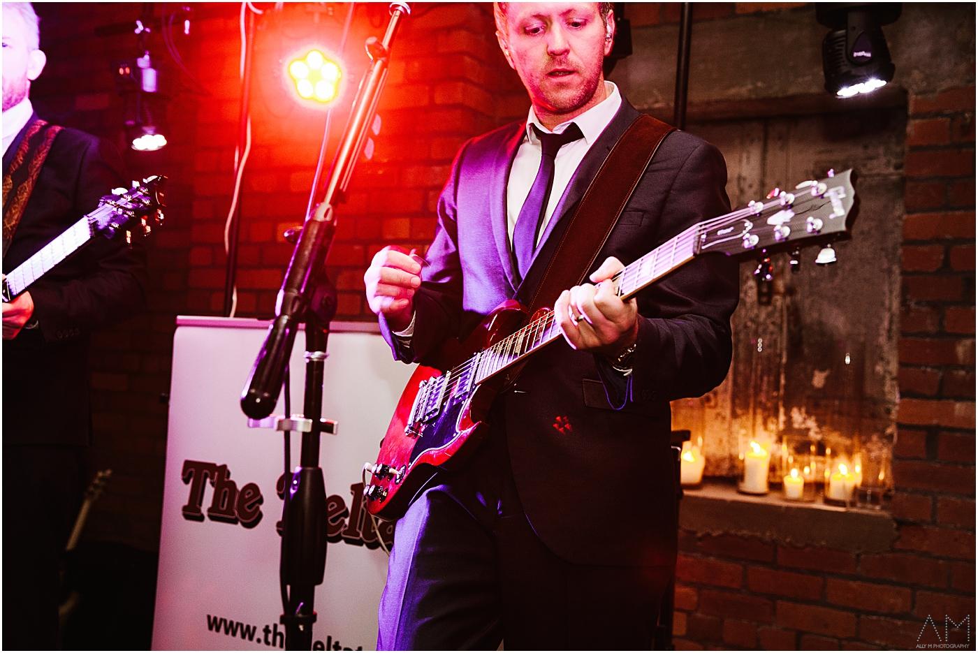 wedding band playing guitar