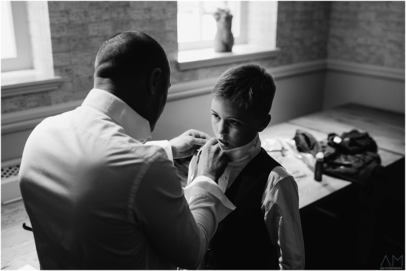 Groom and son before wedding