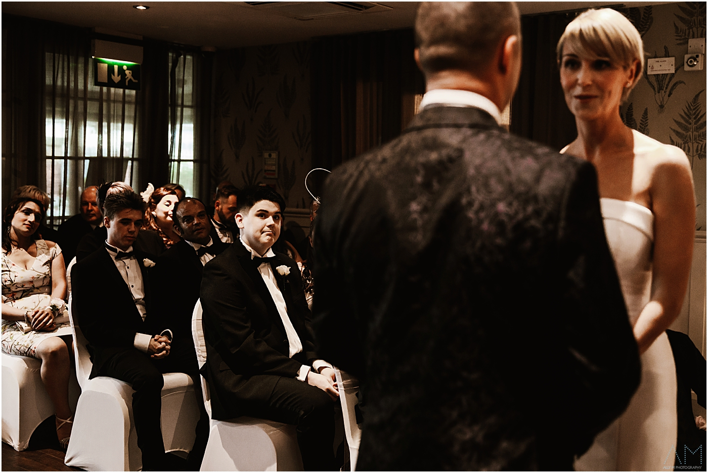 Wedding guest looking on