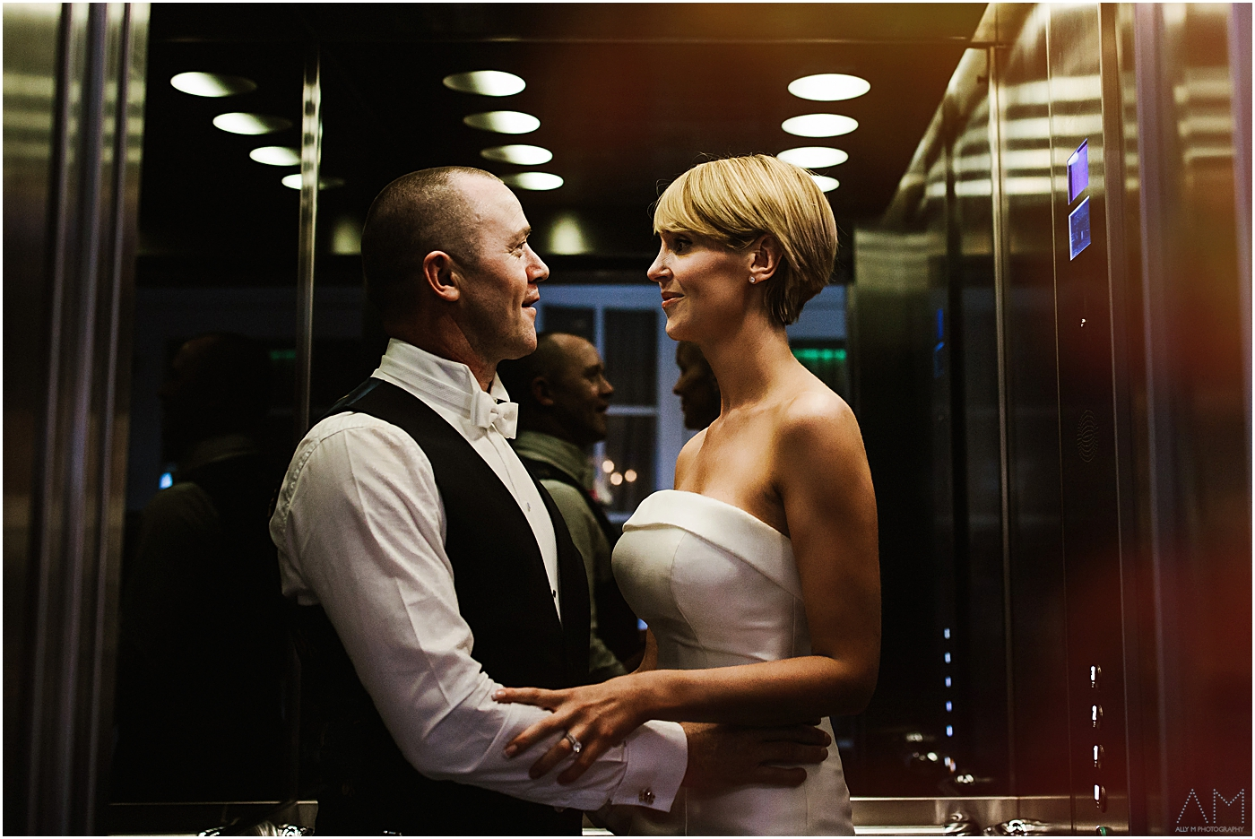 Bride and groom in the lift at Great John Street Hotel