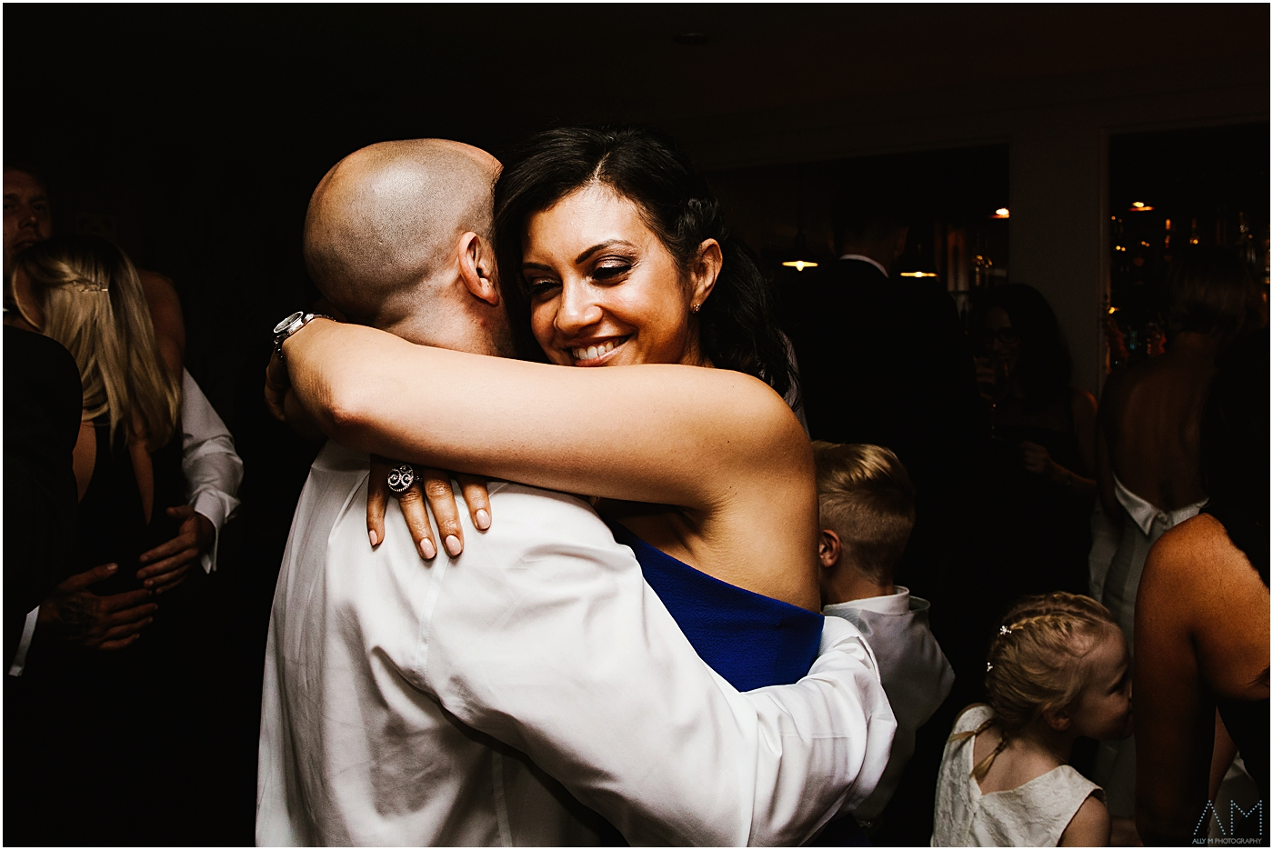 Wedding guests hugging