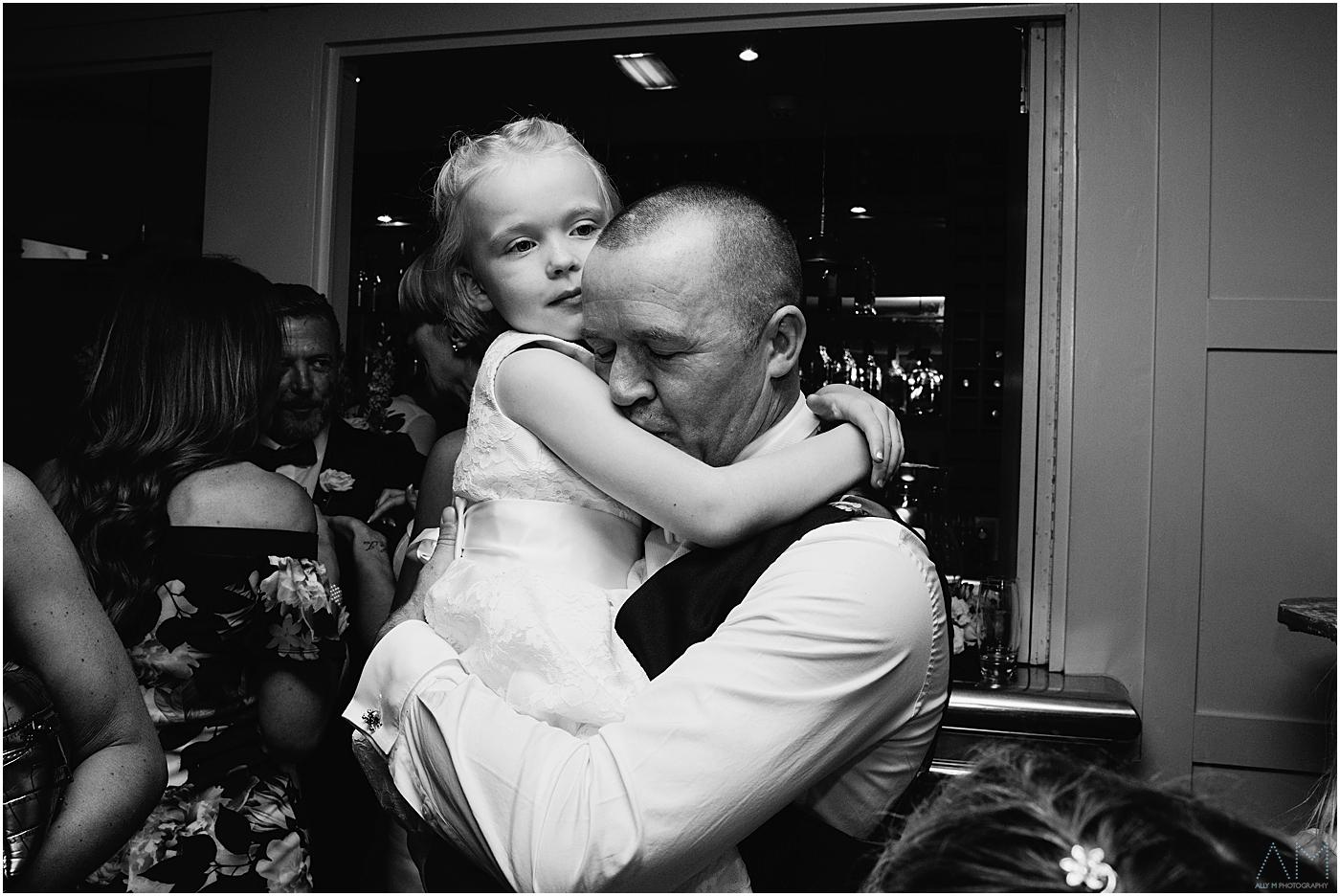 Groom kissing his daughter