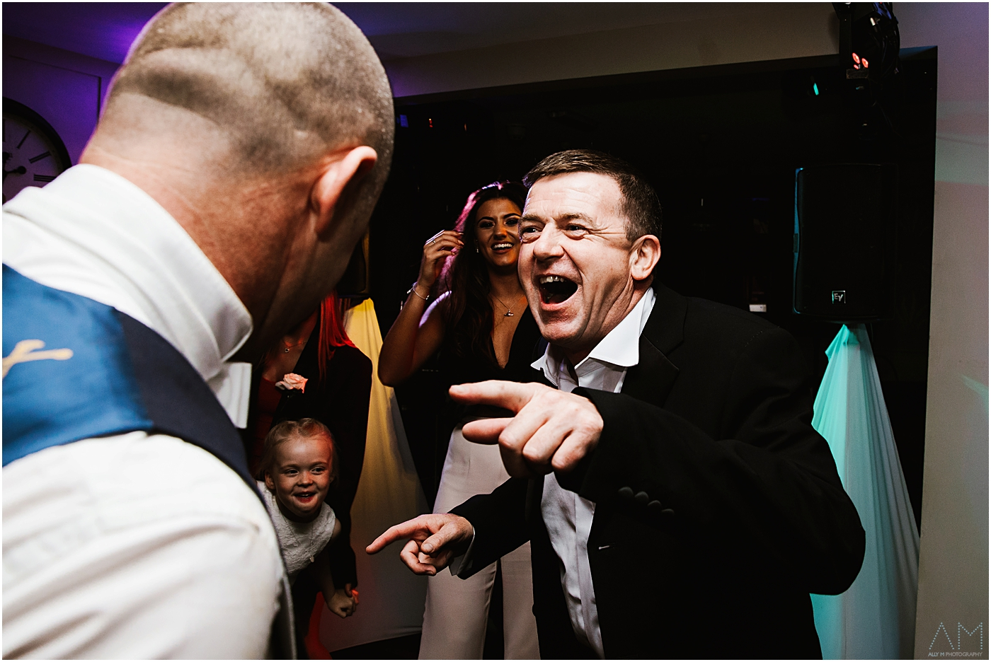 Grooms brother laughing