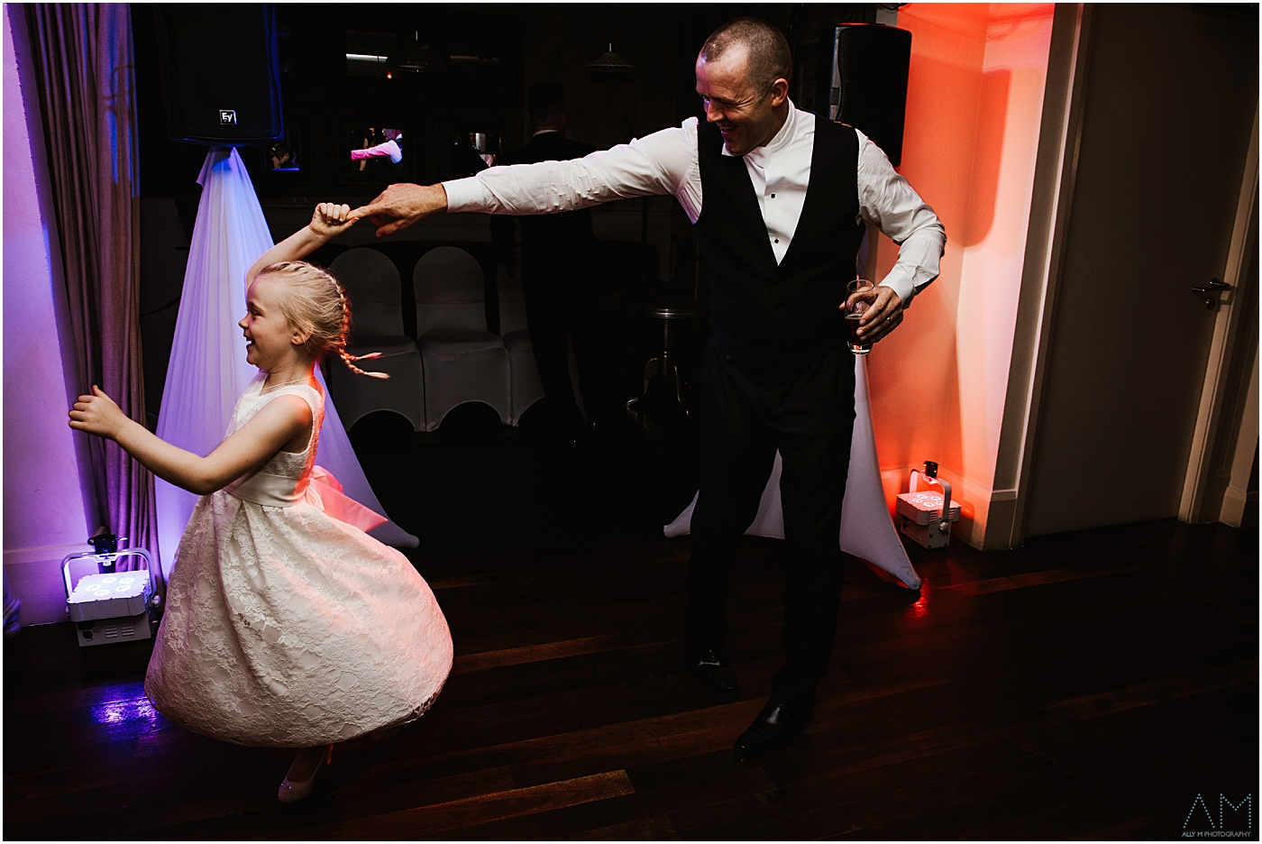 Groom dancing with his girl