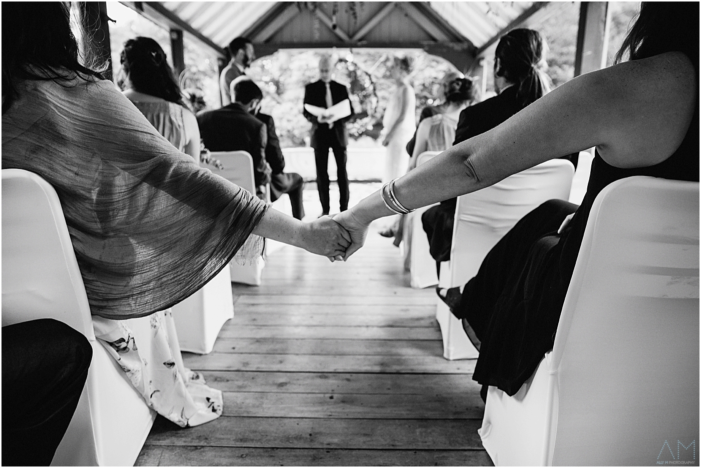 Holding hands at the ceremony