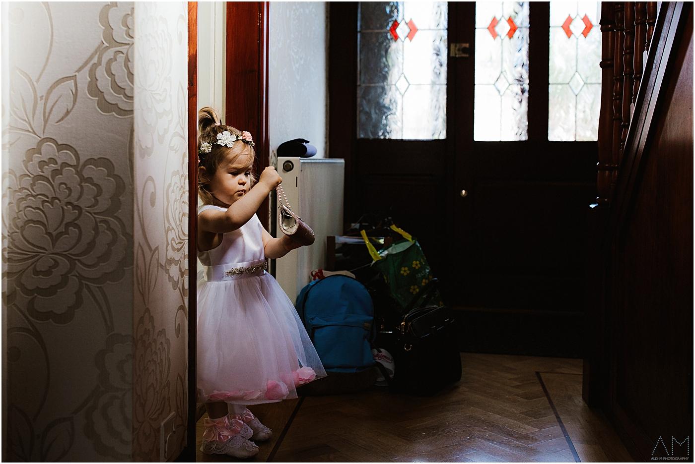 Little girl in her bridesmaids dress