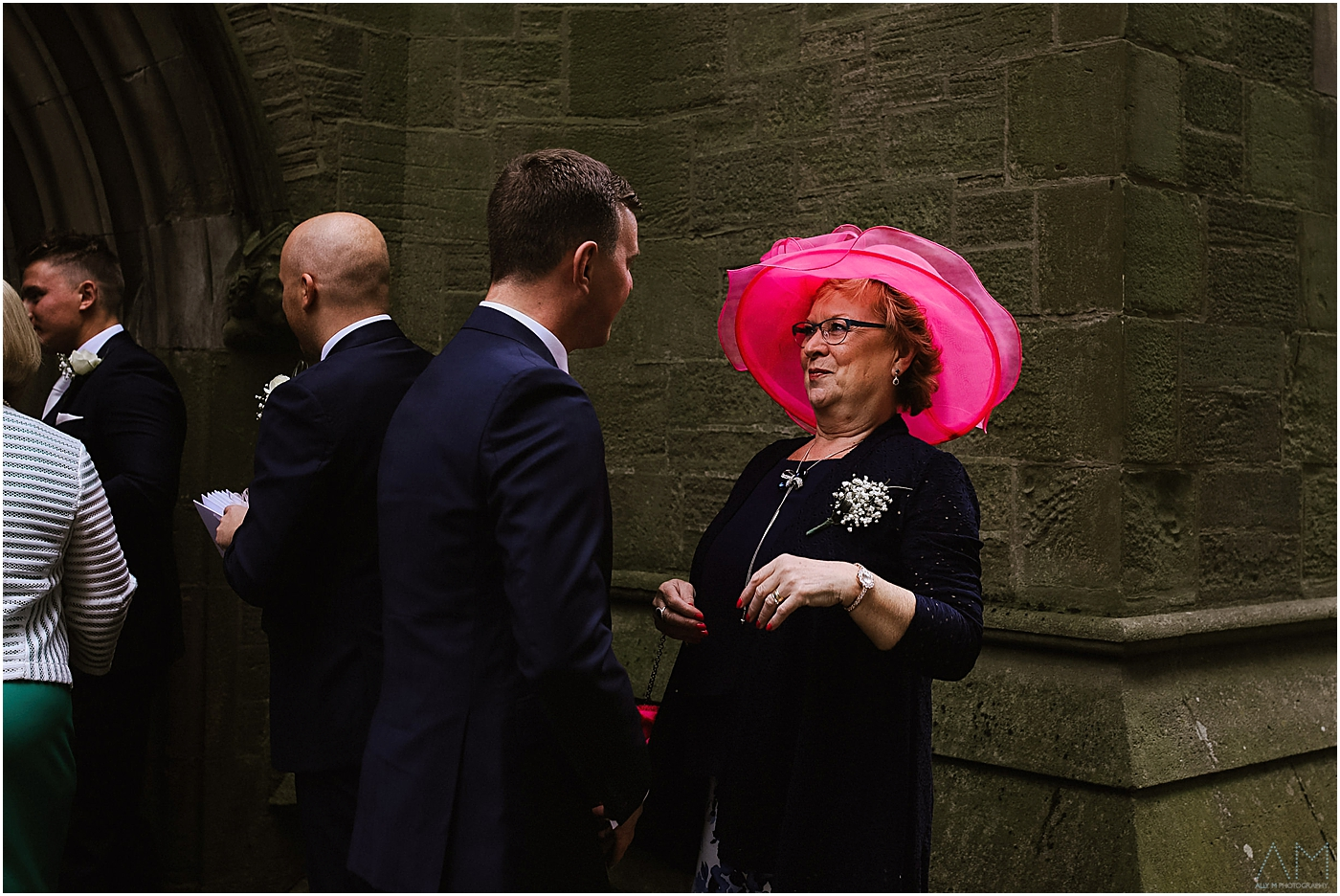 Lady in pink hat outside church