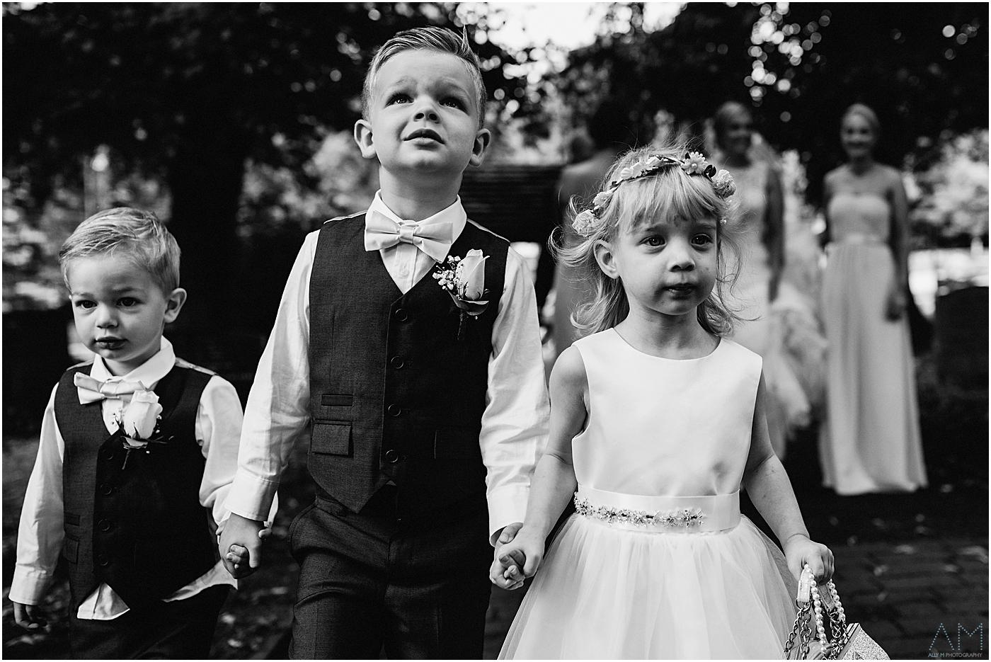 three children making their way to the church