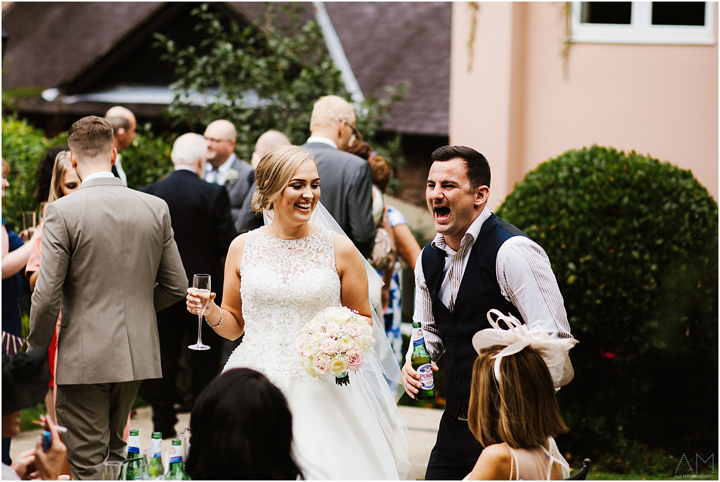 Bride laughing with guest