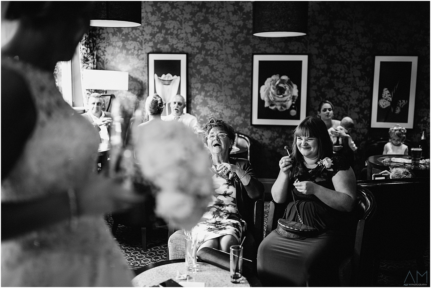 Guests laughing with the bride