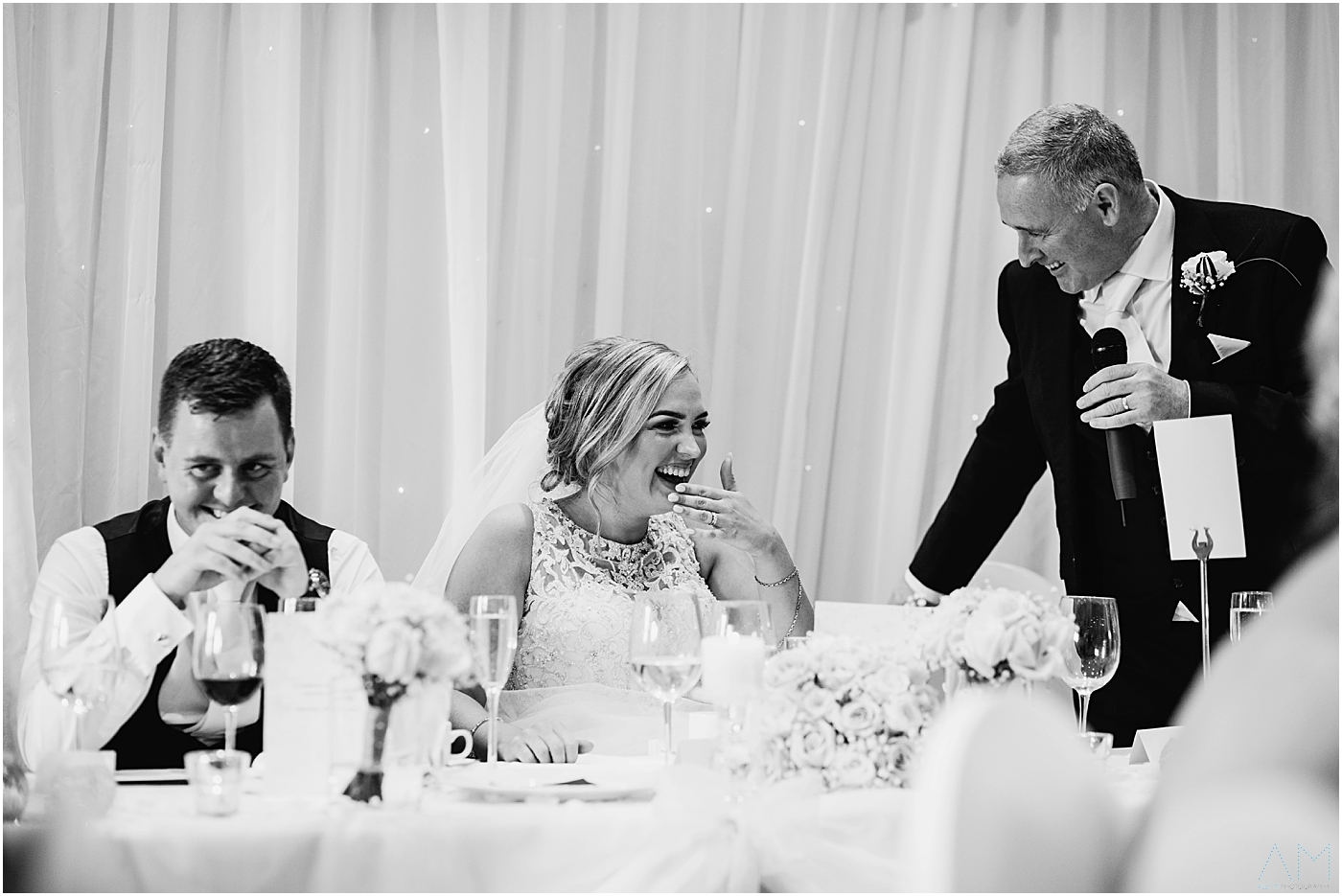 Bride laughing at her Dads speech