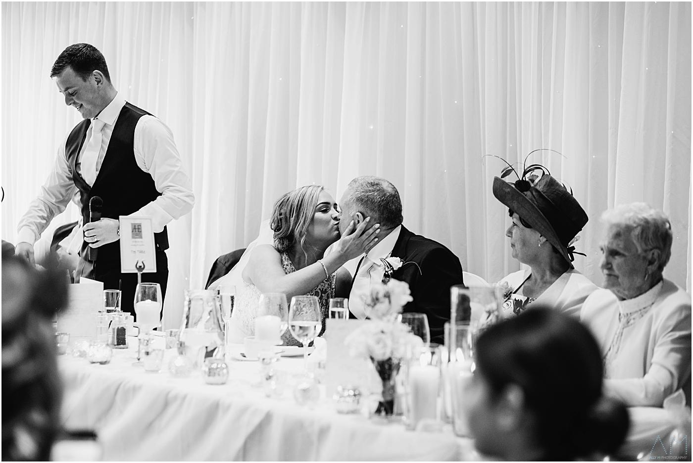 Bride kisses her Dad