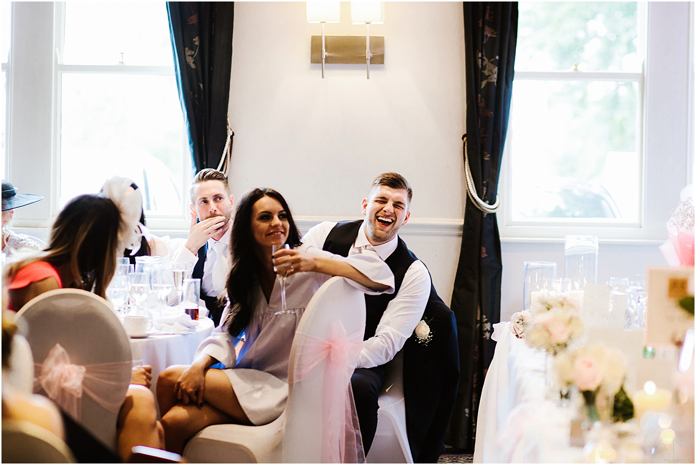 Wedding guest laughing at the grooms speech