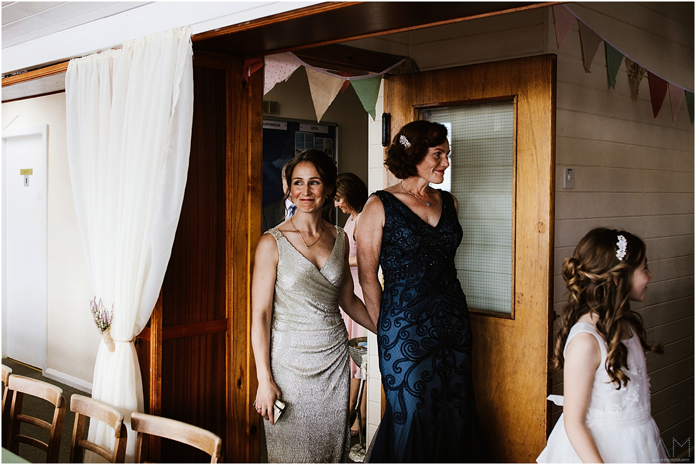 The two brides enter the reception room at Belmont sailing club