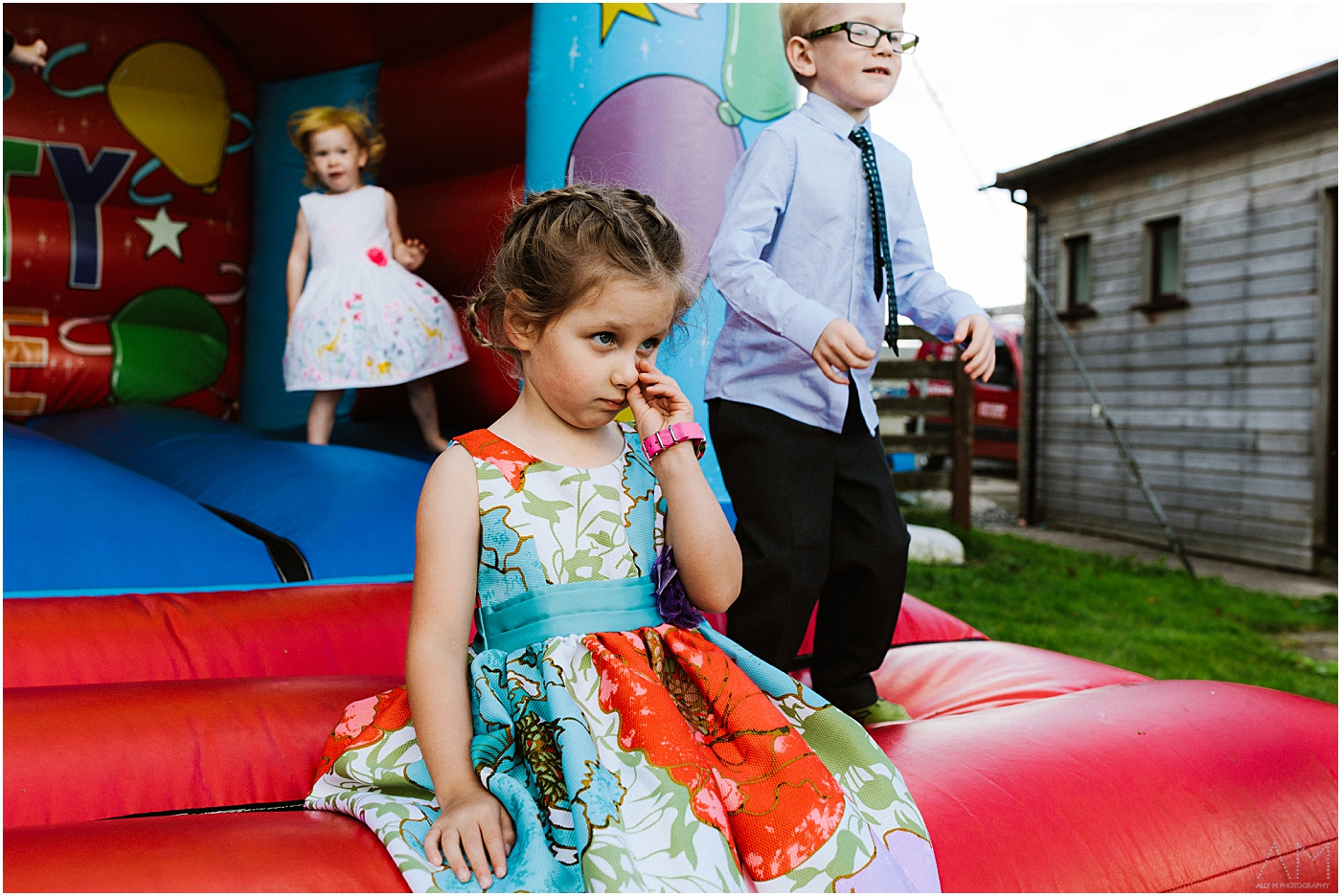Little girl picking her nose at the wedding