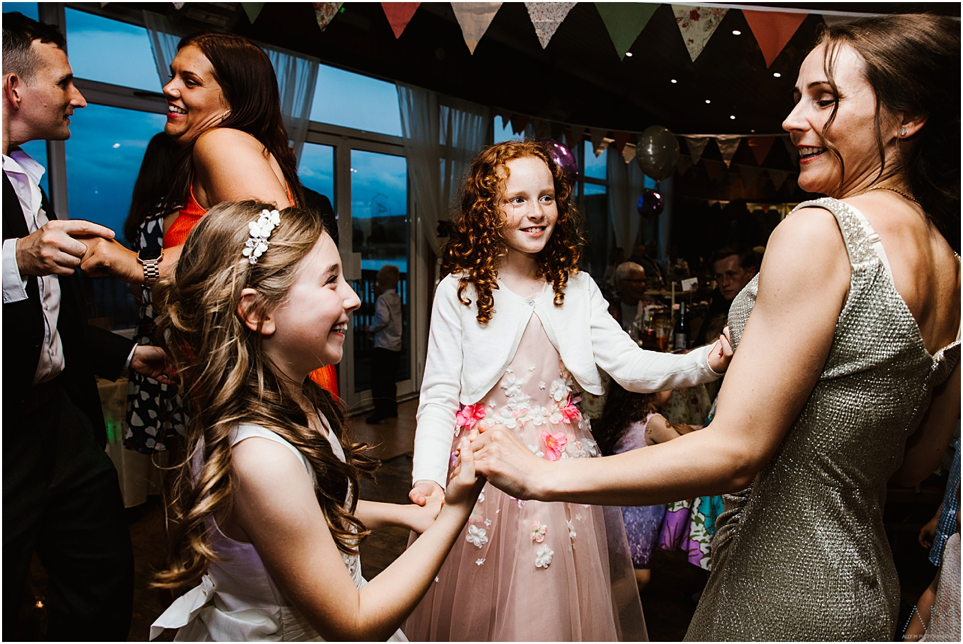 Young girls dancing with teh bride
