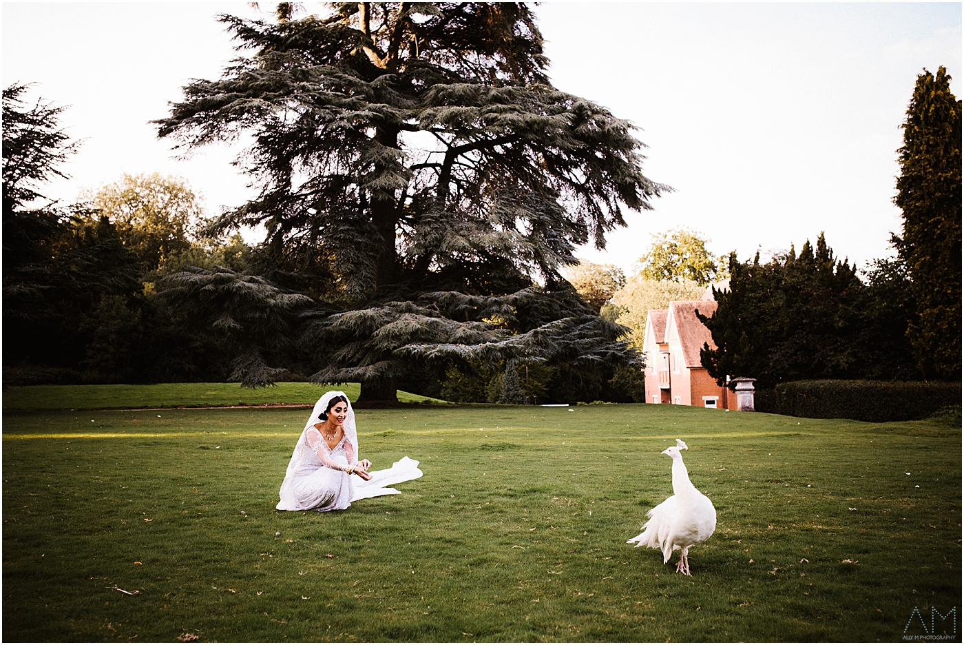 bride with peacock at pendley manor