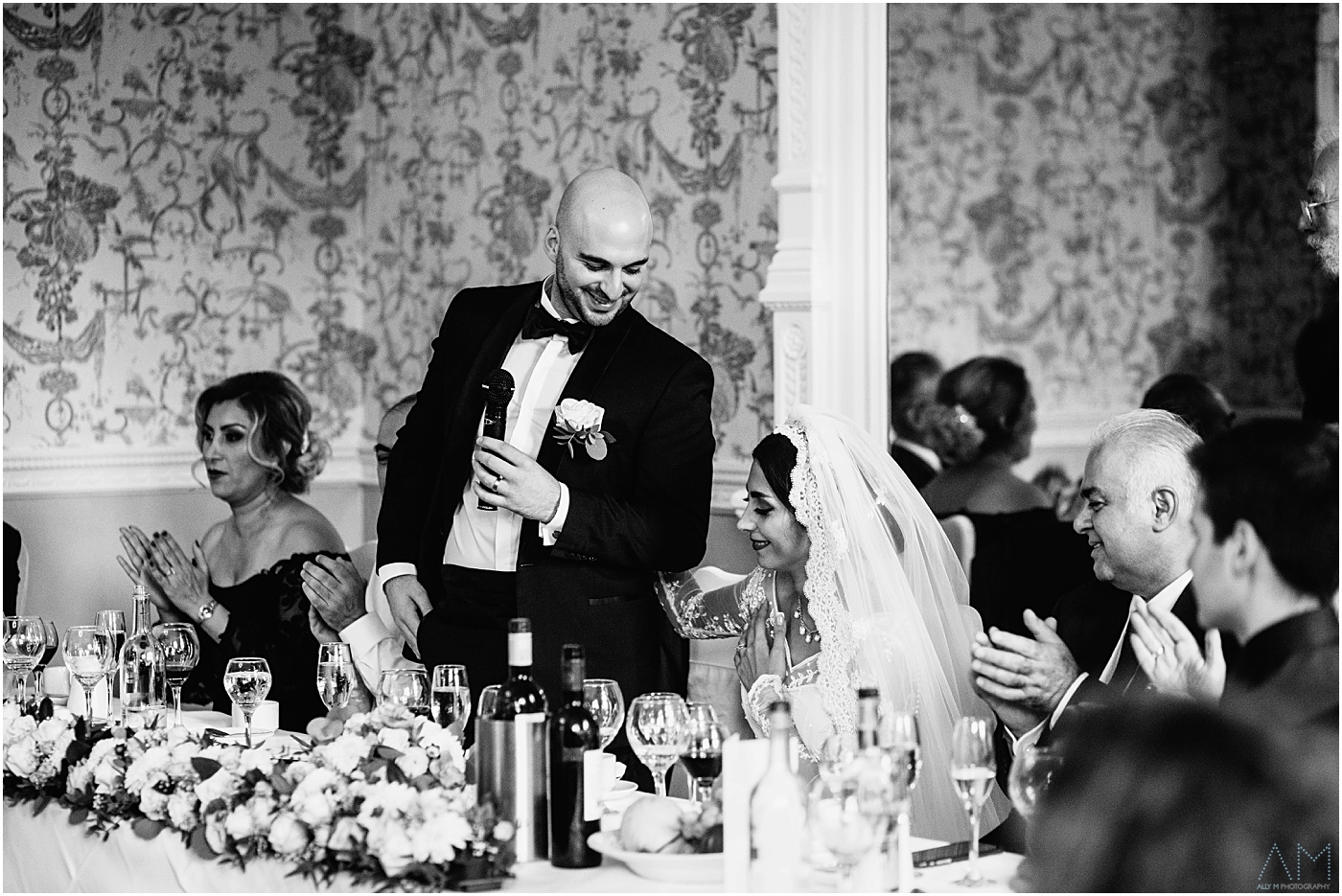 groom looking at his wife during speeches