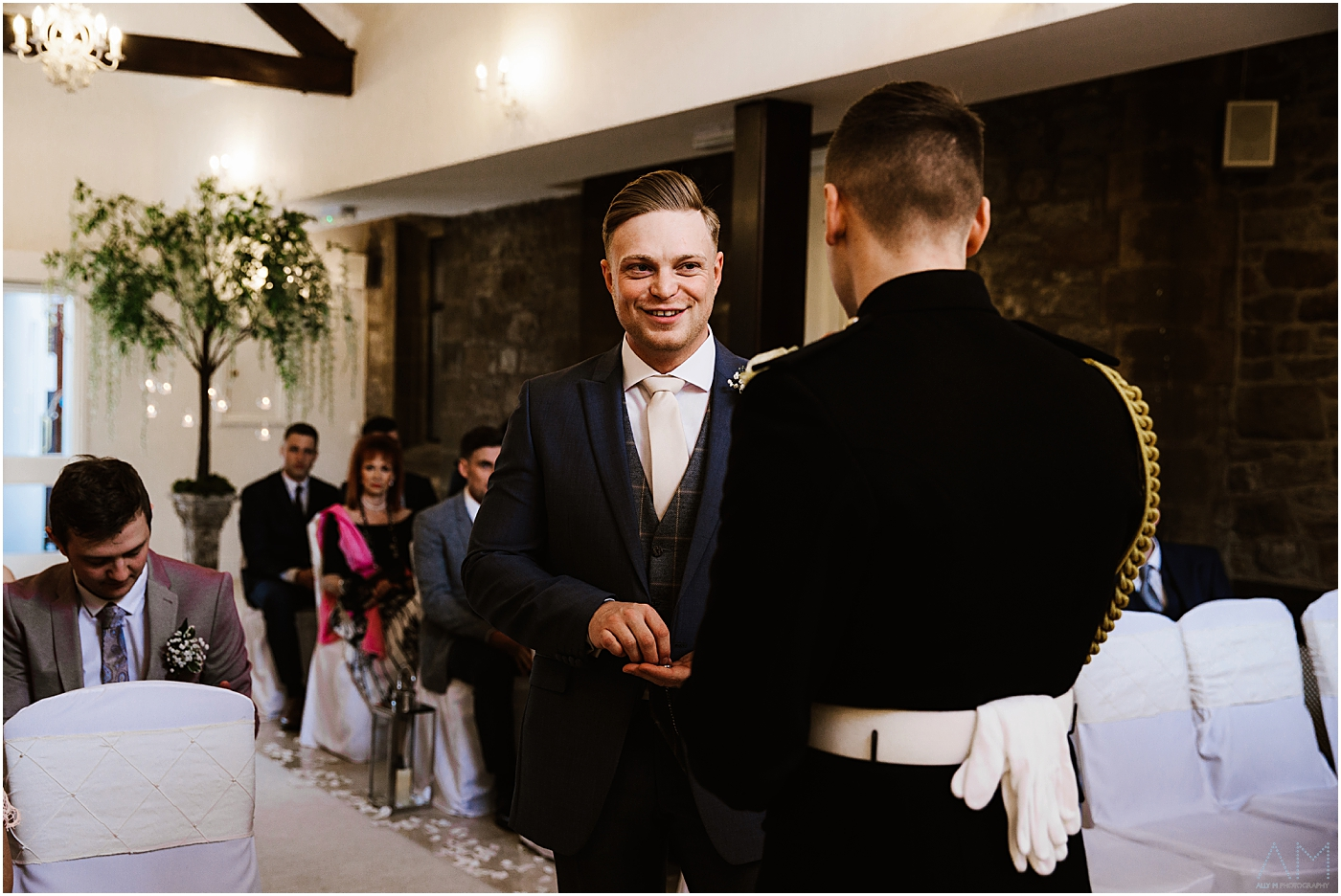 Best man smiling at the groom