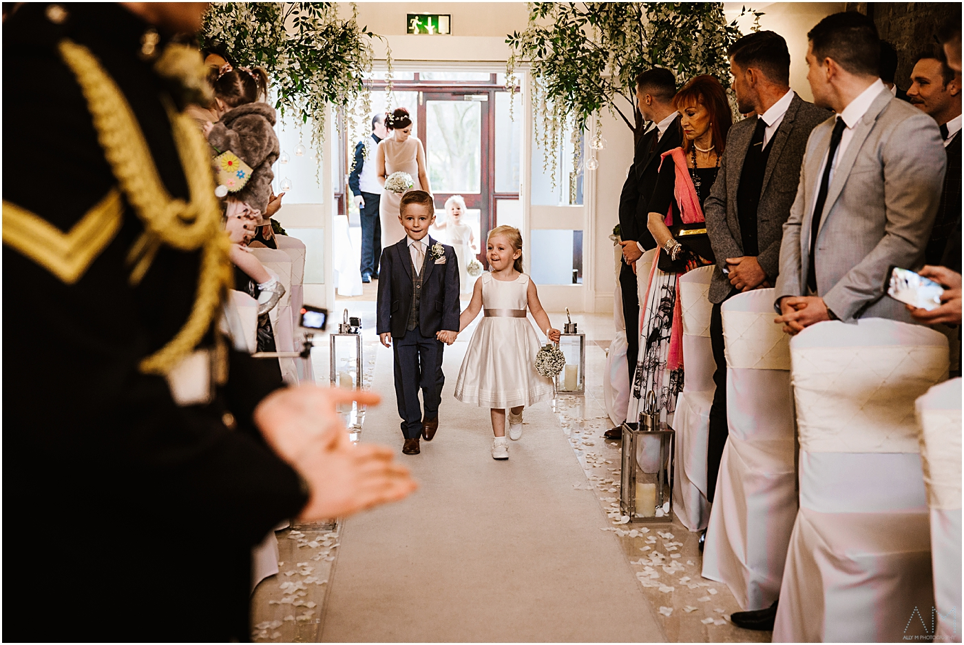 Children walking down the isle