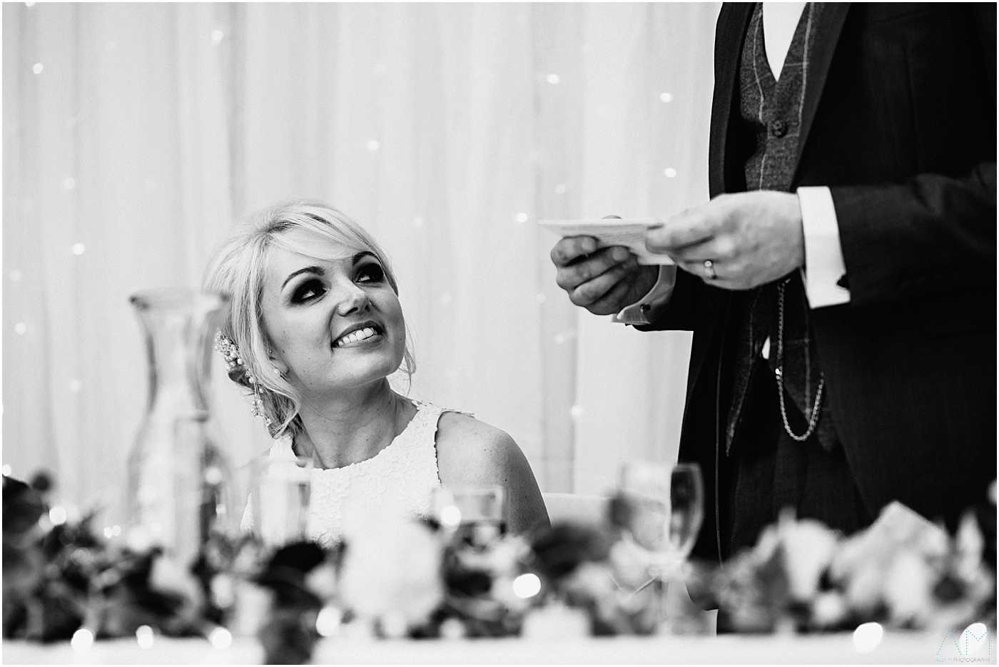 Bride looking at her man during speeches