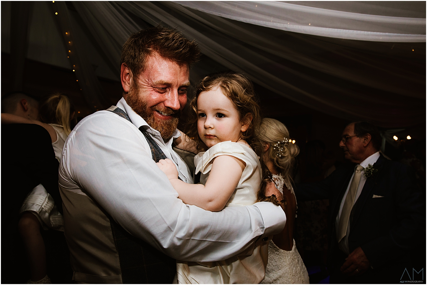 Grooms dad with grandaughter