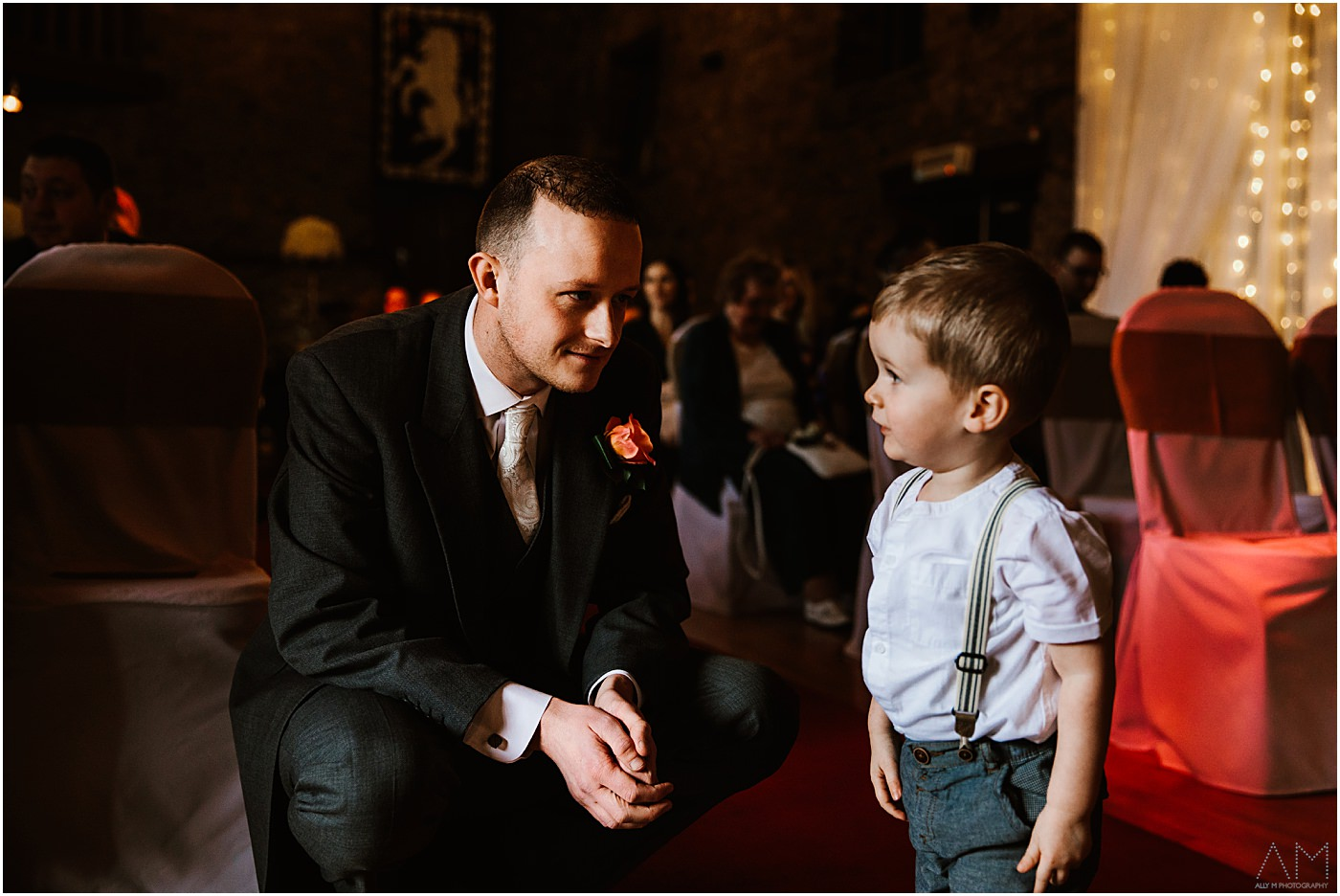 Groom smiling at boy