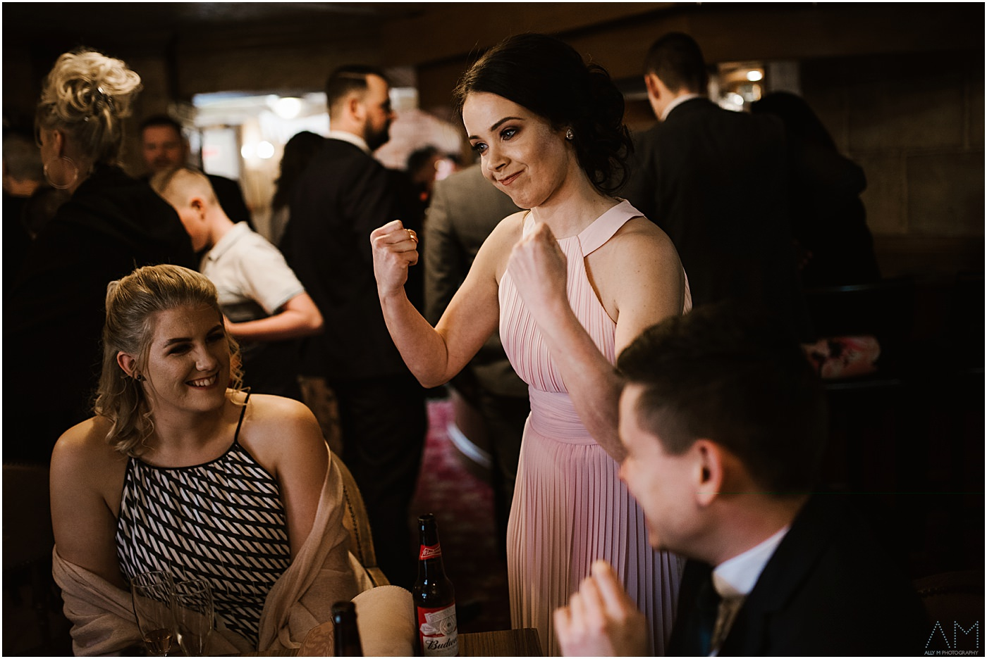 Bridesmaid with fists up