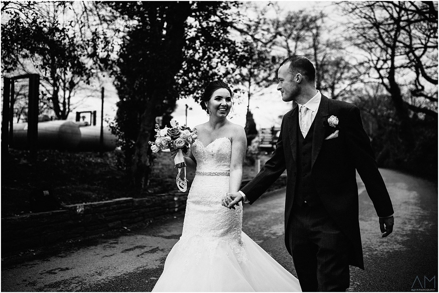 Newly weds having a walk around Park hall hotel