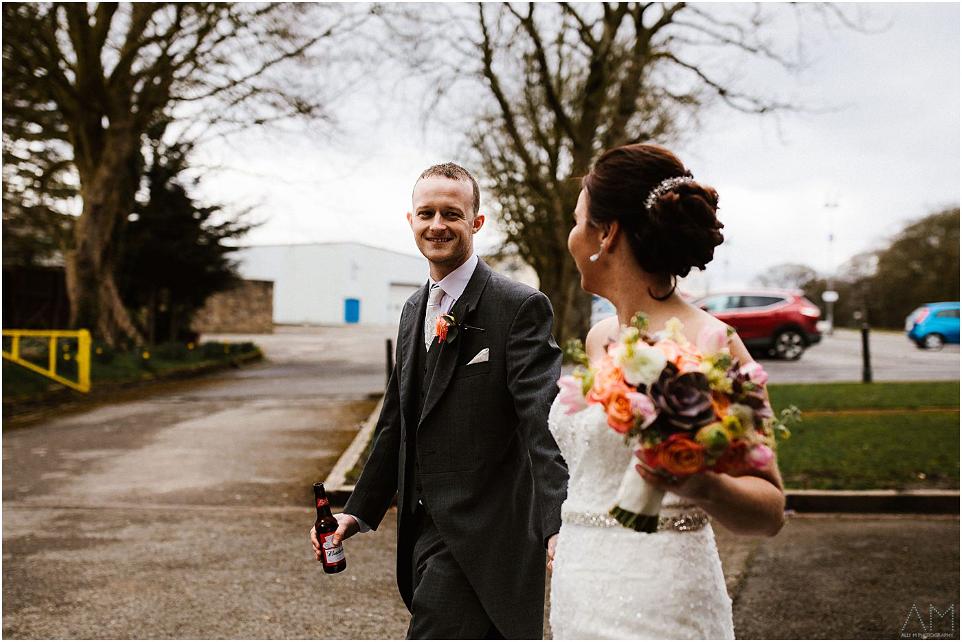 Groom smiling at his wife