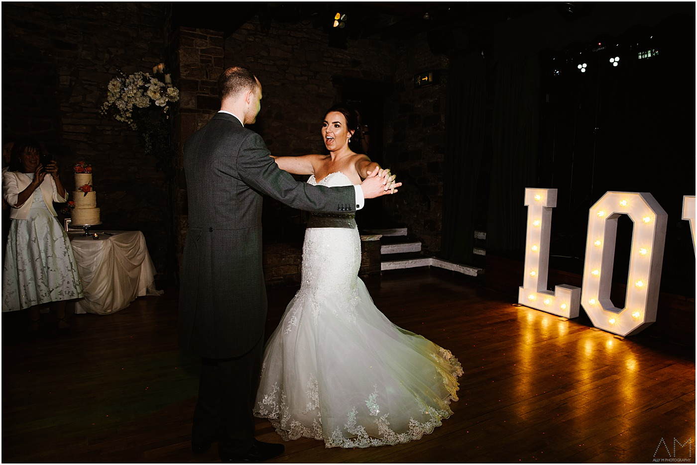 Bride and groom first dance at park hall