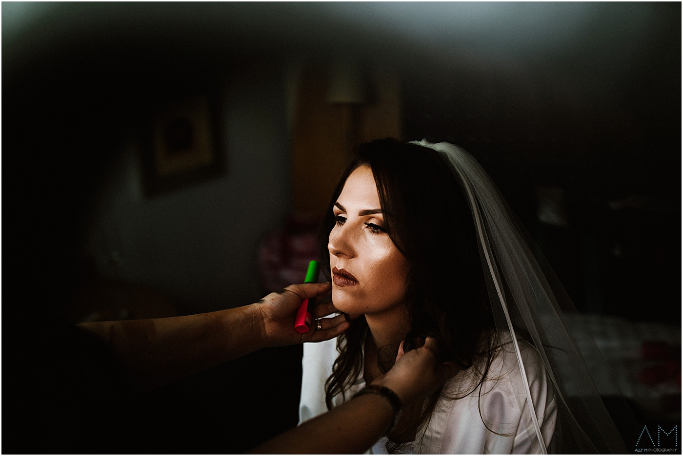 Bride getting ready in her veil