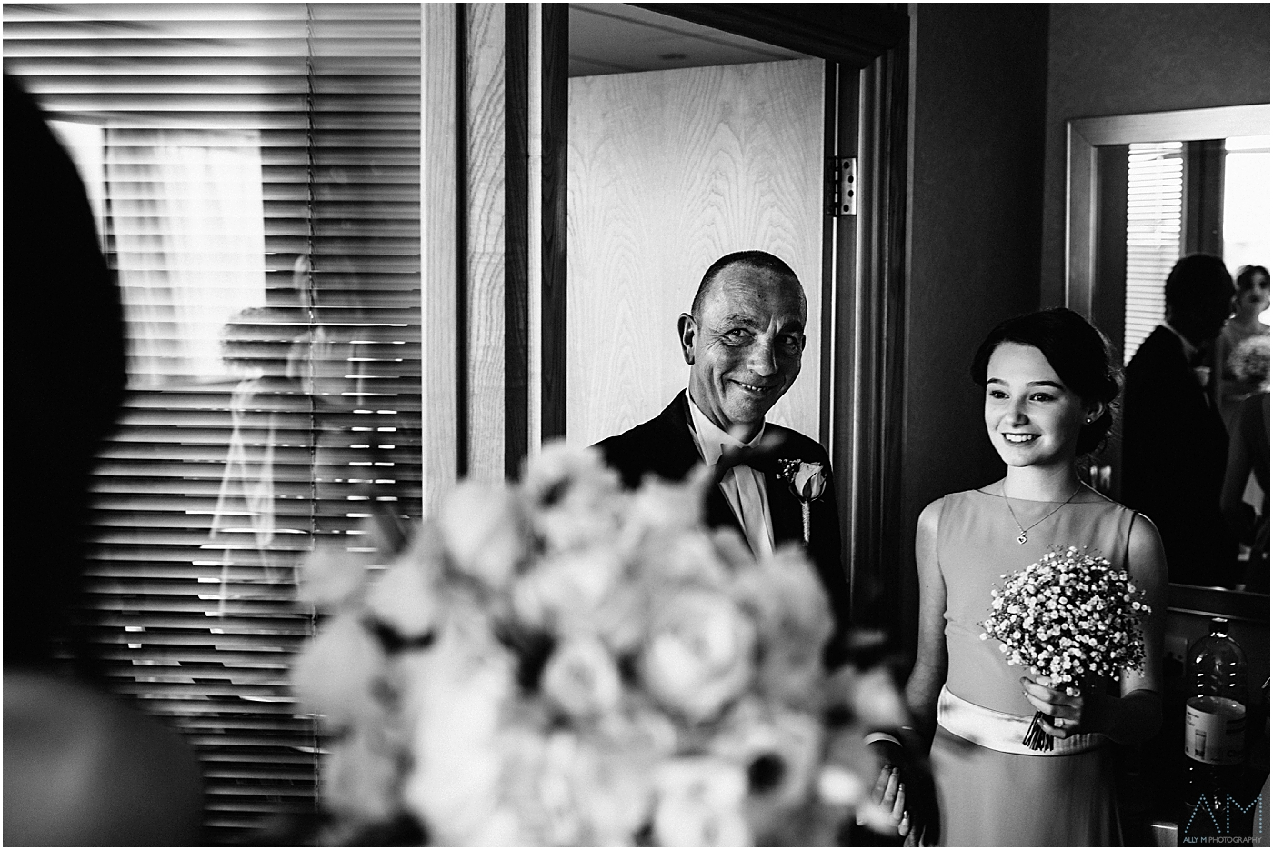father of the bride looks at his daughter in her wedding dress