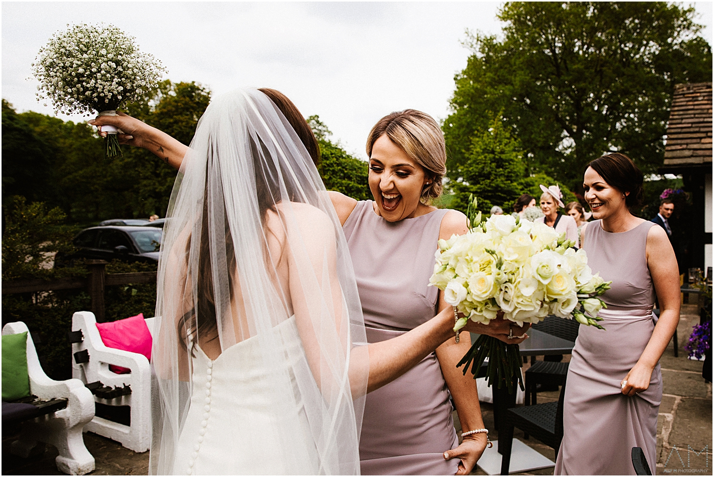 Happy bridesmaid congratulates the bride