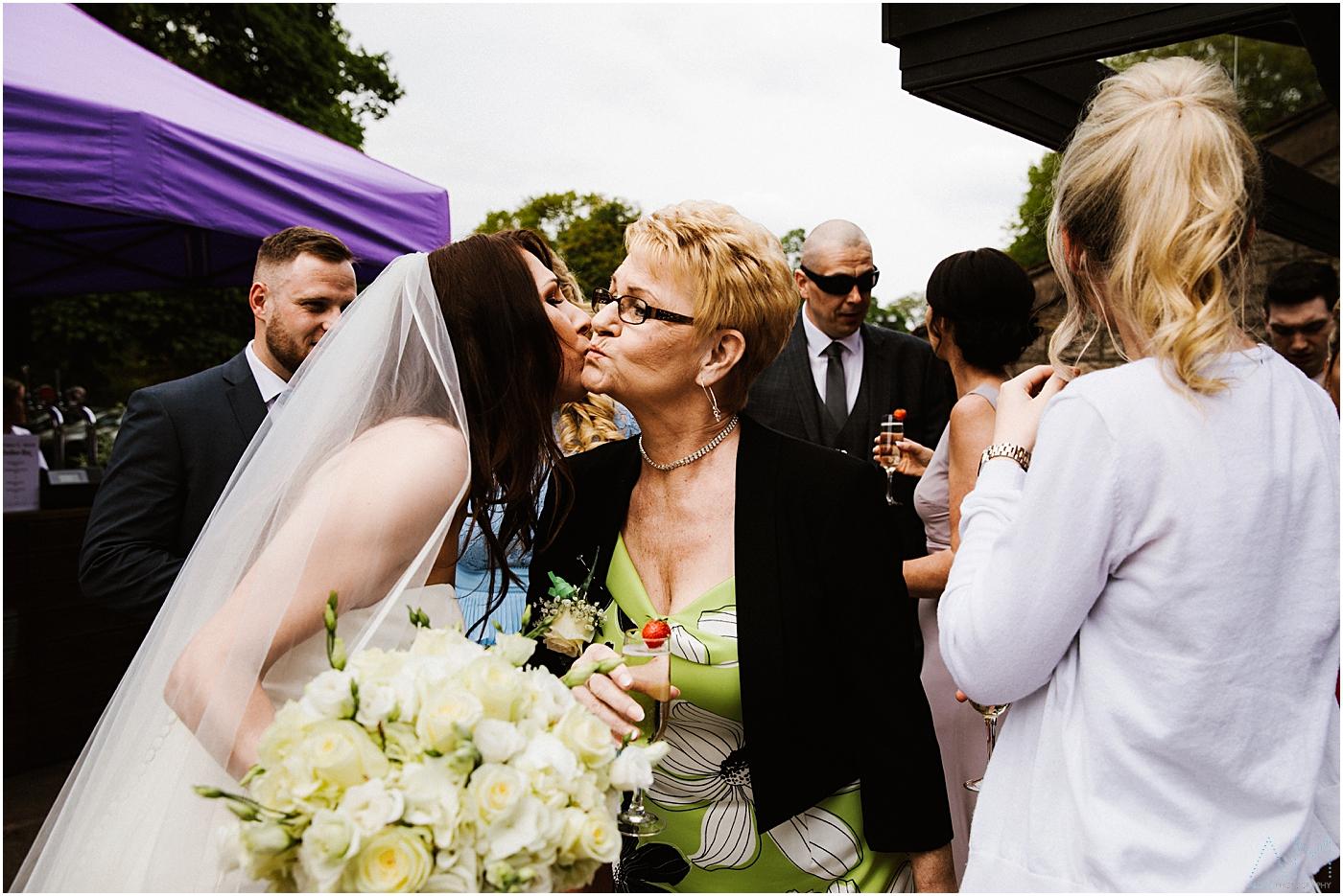 wedding guest kisses the bride