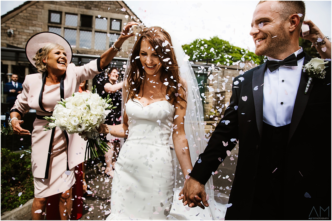 wedding guests throw confetti