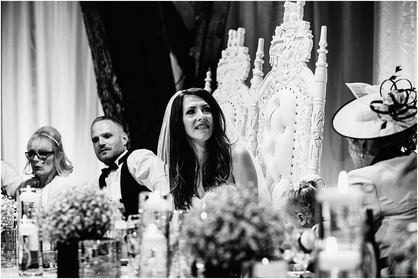 bride looking at her father during the speeches
